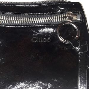 CAuthentic Chloe black leather pouch.